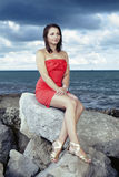 Nice lady posing on the rock. Nice lady posing by the sea for portrait and fashion figure photos in Caorle, Italy stock photos