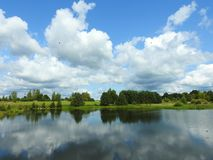 Beautiful small lake, trees and cloudy sky, Lithuania stock images