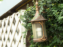 Nice lamp style, In the backyard. Mounted on a wall made of cement. Stock Images