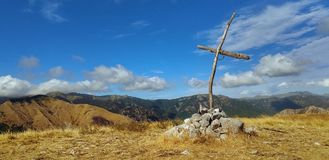 A cross on the Lucca mountain of `Prato Fiorito`. A nice landscape from Bagni di Lucca area in Tuscany Stock Photos