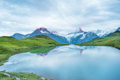 Nice landscape at sunrise over the lake in the Swiss Alps, Europ Royalty Free Stock Photos