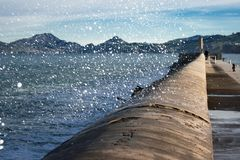 Waves breaking on the wall, Castro Urdiales stock images