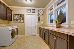 Nice laundry room with tile floor. Stock Photo