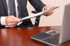 Nice lawyer holding papers stock photography