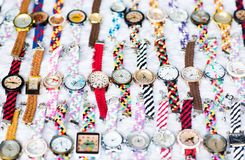 Nice layout of many colorful watches on a white surface. stock photos