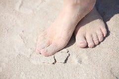 Nice legs on the beach Stock Image