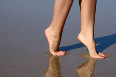 Nice legs walking in water Royalty Free Stock Photos