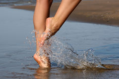 Nice legs walking in water Stock Photos