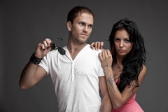 Nice likeable guy with girl on gray background Stock Images