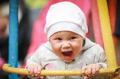 Nice little baby girl laughs Stock Photo