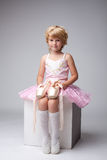 Nice little ballerina posing with pointes Stock Photography