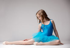 Nice little ballet dancer posing in studio Royalty Free Stock Photography