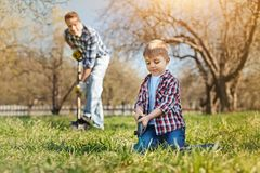 Nice little boy digging the ground Royalty Free Stock Photography