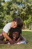 Nice little boy and his black sister Royalty Free Stock Image