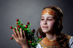 Nice little dancer posing with twig of berries Royalty Free Stock Photography