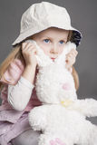 Nice Little Female Child Holding Toy and Dreaming,  Agai Stock Images