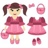 Nice little girl with bag and clothes Royalty Free Stock Photo