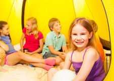 Nice little girl in camping tent with friends Royalty Free Stock Photo