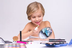 Nice little girl doing make up Stock Image