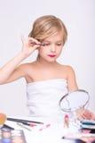 Nice little girl doing make up Stock Images