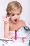 Nice little girl doing make up Stock Photography
