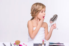 Nice little girl doing make up Royalty Free Stock Images