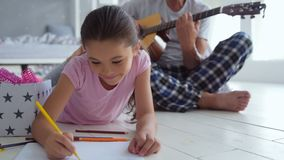 Nice little girl drawing at home stock footage