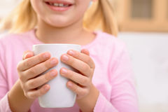 Nice little girl drinking tea Royalty Free Stock Images