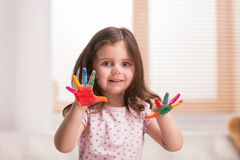 Nice little girl with hands in paint. Stock Photography