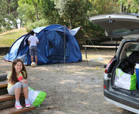 Nice little girl and her brother while installing the tent in th Stock Photography