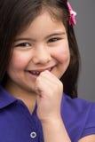 Nice little girl holding lip. Stock Image