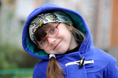 Nice little girl in  hood ofblue coat Royalty Free Stock Photos