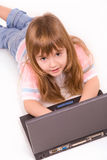 Nice little girl with laptop Stock Photos
