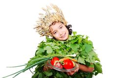 Nice little girl in leafs cloths with wheat hat Stock Photography