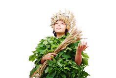 Nice little girl in leafs cloths with wheat hat Stock Image
