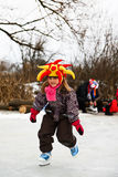 Nice little girl learning ice skating. Nice smiling little girl learning ice skating outdoors Stock Images