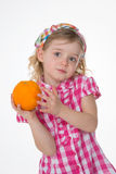 Nice little girl loves fruit Royalty Free Stock Photography