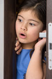 Nice little girl opened door. Royalty Free Stock Photo