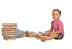 Nice little girl with pile of books isolated Royalty Free Stock Images