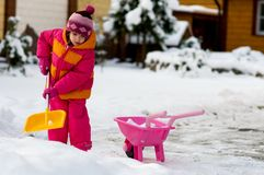 Nice little girl playing with snow Stock Photos