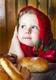 Little  girl in  Russian shawl with rolls and honey Stock Photography