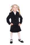 Nice little girl in a school uniform Stock Images