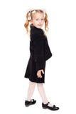 Nice little girl in a school uniform Stock Photos