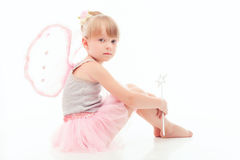 Nice little girl sitting on the floor Stock Images