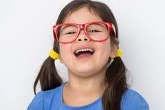 Nice little girl wearing glasses. Stock Images