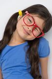 Nice little girl wearing red glasses. Stock Image