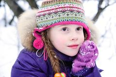 Nice little girl in a winter woods Stock Photography