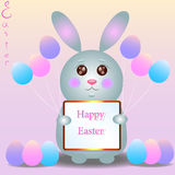 Nice little rabbit with balloons Happy Easter. Rabbit baby holds in paws a sign with a wish Happy Easter Stock Photos