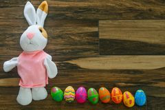 Nice little rabbit lie on the floor. With easter eggs stock images