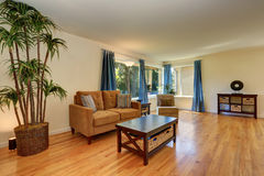 Nice living room in blue and brown colors with hardwood floor. Stock Photos